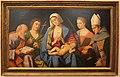 Vincenzo catena, madonna col bambino, santi e il donatore ludovico ariosto, 1512 ca.JPG