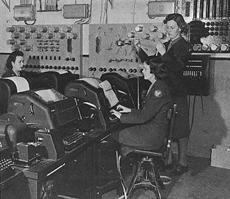Edith Nourse Rogers - WACs assigned to the Eighth Air Force in England operate teletype machines.