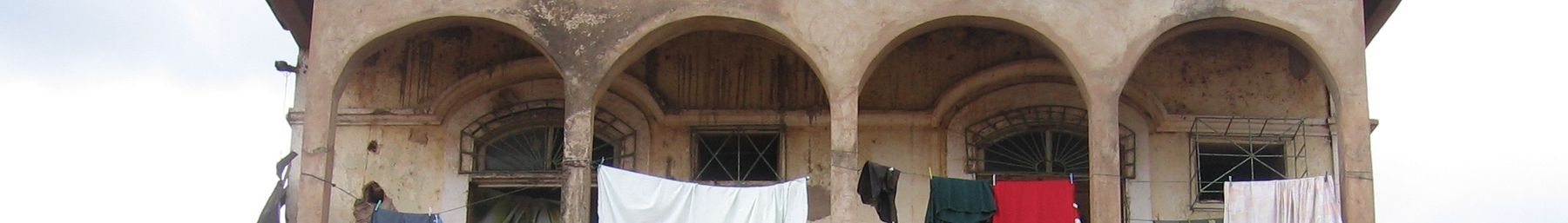 WV banner Bissau Clothes on old building.jpg