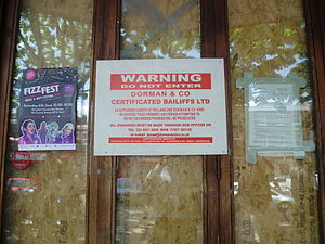 Bailiff - Bailiff's notice on boarded-up premises, London, 2015.