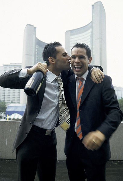 Mathieu Chantelois and Marcelo Gomez getting married in Toronto, July 2003. They were among the first to tie the knot when same-sex marriage became legal in Ontario. The rest of Canada followed suit within a couple of years. Someday, I will be trying to explain why couples like Chantelois and Gomez were pioneers simply for loving each other and insisting on getting married, and those kids won't understand, because the pioneers will have made it all perfectly normal, just as it should be. Image courtesy Mm.Toronto via Wikimedia Commons.