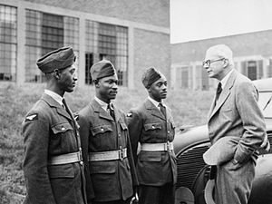 British Guiana during World War II - West Indians in the Royal Air Force: The Secretary of State for the Colonies, Oliver Stanley, seen chatting with three volunteers (Left to right: AC W. P. Ince of British Guiana, AC E. Johnson of Jamaica, and AC S. E. Johnson of Jamaica) during a passing out parade of West Indians at a Royal Air Force station in Yorkshire.