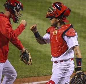 Yadier Molina - Yadi fist bumps the temporary catcher in 2016
