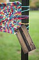Yarn bomb - granny square on fence (5521345948).jpg