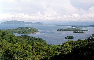 Jayapura - Looking east to Yos Sudarso Bay, showing the floating village of Tobati (left) and Engros (right), just to the south of Jayapura.