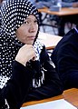 Zehra, Afghan criminal investigative division, takes notes during a lecture.jpg