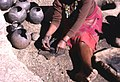 Zulu woman at a reconstructed traditional village in South Africa rolling clay for pottery making-7716.jpg