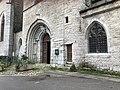 Église Notre-Dame d'Orgelet - entrée et panneau MH.JPG