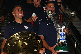 Jonathan Soriano - Salzburg celebrating their 2015 double: Soriano is holding the Bundesliga shield, and Alexander Walke holds the Austrian Cup.