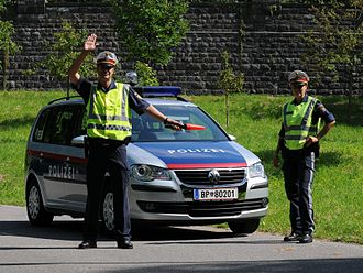 Traffic stop - Austrian police officers signaling drivers to pull over as part of a traffic stop
