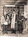 Зліва направо, дяк Михайло Ільницький, о. Василь Маковійчук, паламар Василь Юрійчук, с.Хомчин 1930 р.jpg