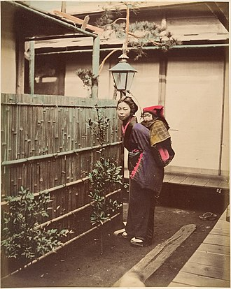 Suzuki Shin'ichi I - Image: Japanese Woman in Traditional Dress Posing with a Child on her Back MET DP155411
