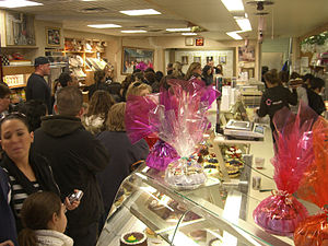 Cake Boss - The interior of Carlo's Bake Shop on a busy holiday.
