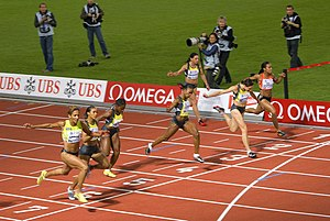100 metres - Christine Arron (left) wins the 100 m at the Weltklasse meeting.