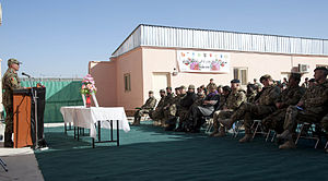 Camp Julien - An audience of senior officers from both the Afghan National Army and Coalition forces attend a ceremony establishing the Mentor House Infantry School being handed back to the ANA, Dec. 31 2011.