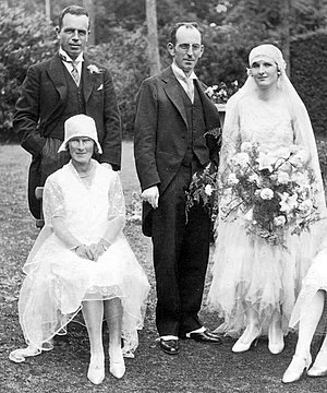 Bride - The woman to the far right is wearing a typical wedding dress from 1929. Up until the late 1930s wedding dresses reflected the styles of the day. From that time onward, wedding dresses have been based on Victorian ballgowns.