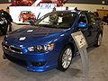 2009 blue Mitsubishi Lancer GTS 2.4L front side.JPG