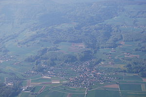 Attiswil - Aerial view of Attiswil (center, foreground) and surrounding villages and countryside.