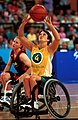 251000 - Wheelchair basketball Julianne Adams shoots - 3b - 2000 Sydney match photo.jpg
