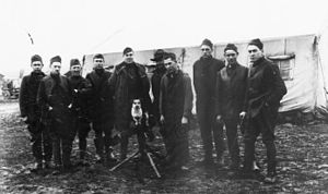 28th Aero Squadron - Squadron lead Non-Commissioned officers (with camp mascot dog on a machine gun), November, 1918