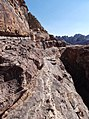 40 Petra High Place of Sacrifice Trail - Gregory Shooting Videos on the Trail Past the Monastery - panoramio.jpg