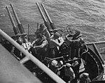40mm gun mount firing aboard USS Saipan (CVL-48), circa in 1946.jpg