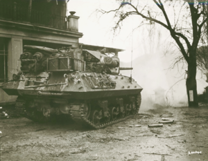 303rd Cavalry Regiment (United States) - An M10 tank destroyer from the battalion firing on a German pillbox on the other side of the Sauer River near Echternach, Luxembourg, supporting an advance by the 5th Infantry Division's 11th Infantry Regiment.
