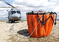A Griffin helicopter from 84 Squadron, RAF Akrotiri lifts off with a 'Rainmaker' water bucket MOD 45147998.jpg