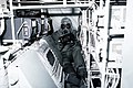 A crewman in protective clothing performs maintenance aboard a C-130 Hercules aircraft during a chemical warfare training exercise - DPLA - 36e9c7268016bda7e268203cea56f14c.jpeg