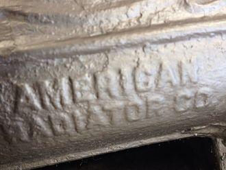 American Radiator Company - A logo on a radiator from American Radiator Co.