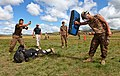 A member of the Mongolian Armed Forces, left, participates in a pepper spray qualification course as part of the Non-Lethal Weapons Executive Seminar (NOLES) 2013 field training exercise Aug. 21, 2013, at 130821-M-MG222-011.jpg