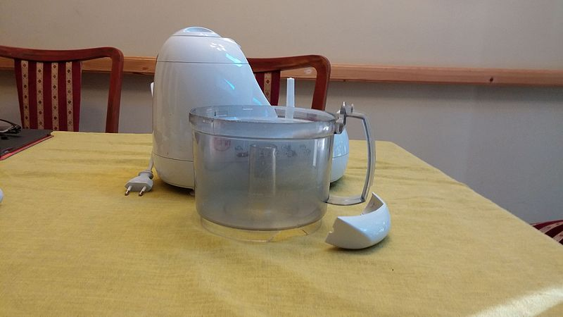 A plastic handle which came loose from the food processor bowl