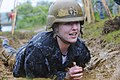 A plebe crawls through a trench during the class of 2019 Sea Trials event at the U.S. Naval Academy. (27058235606).jpg