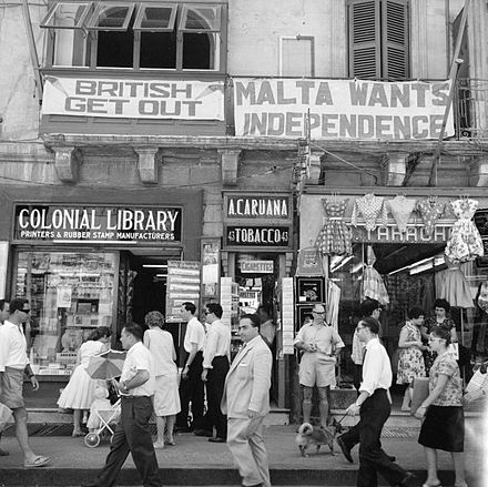 A view of shops with anti-British and pro-Independence signs, Malta, c. 1960 A view of shops with anti-British and pro-Independence signs, possibly on Kings Street, Valetta, Malta (5074435957).jpg
