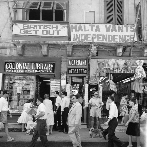 A view of shops with anti-British and pro-Independence signs, possibly on Kings Street, Valetta, Malta (5074435957)