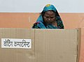 A woman voter casting her vote, at a polling booth, during the 9th Phase of General Elections-2014, in Varanasi, Uttar Pradesh on May 12, 2014.jpg