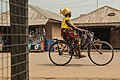 African lady looking stylish on her bicycle.jpg