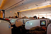 Air New Zealand Boeing 777-200ER cabin with mood lighting.
