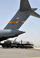 Air Transportation Airmen From the 380th Expeditionary Logistics Readiness Squadron's Air Terminal Operations Center Drives a 60,000-pound-capable Aircraft Loader to Unload a Plane During Operations DVIDS290892.jpg