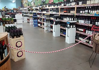 Blue laws in the United States - The alcohol aisle of a grocery store in Chapel Hill, North Carolina, on a Sunday morning. The aisle is roped off for compliance with the state's alcohol laws.