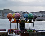 All the fun of the fair Children's ride at the land side end of the pier Llandudno.