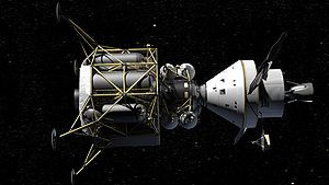 Orion (right) flies in space while docked with...
