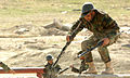 An Afghan National Army recruit goes through an obstacle course during training (4434979105).jpg