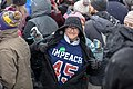 An Amy Klobuchar supporter wears an Impeach 45 t-shirt at Senator Klobuchar's rally to announch her 2020 presidential bid (47055564751).jpg