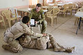 An Australian soldier assigned to Task Group Taji evaluates an Iraqi soldier assessing a casualty.jpg