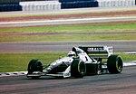 Andrea de Cesaris - Sauber C13 at the 1994 British Grand Prix (32418704201).jpg