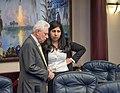 Anna Eskamani and Richard Stark confer on the House floor.jpg