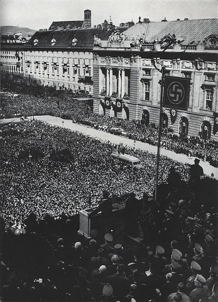 Austrian citizens gather in the Heldenplatz to hear Hitler's declaration of annexation.