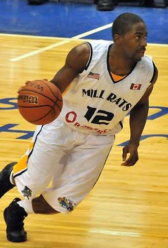 Anthony Anderson (basketball) - Anderson dribbles the ball for the Mill Rats in 2011.