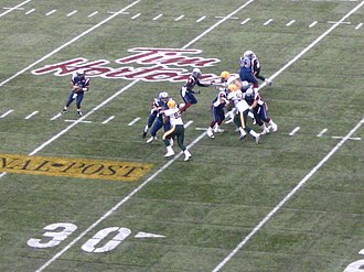 Grey Cup - Montreal Alouettes quarterback Anthony Calvillo looks down field with the ball during the 2005 Grey Cup against the Edmonton Eskimos at BC Place Stadium.